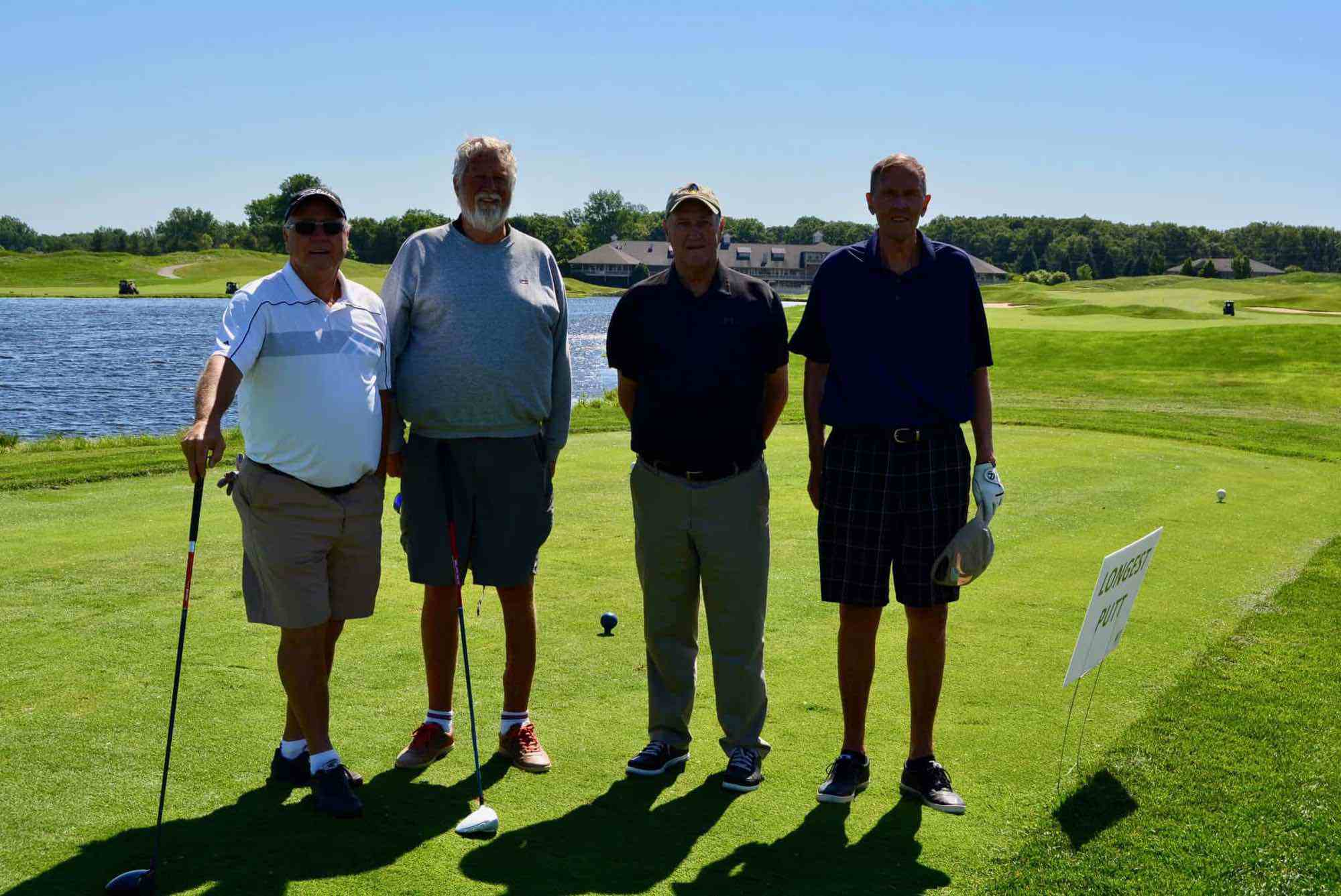 MTM RECOGNITION FOURSOME (Left to right): Jim Hoekwater, Andy DeVries, Ed Douma (Winner of the Men's Longest Drive), Dave Zondervan.