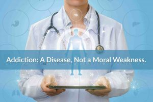 Doctor holding a tablet: Addiction a disease not a moral weakness