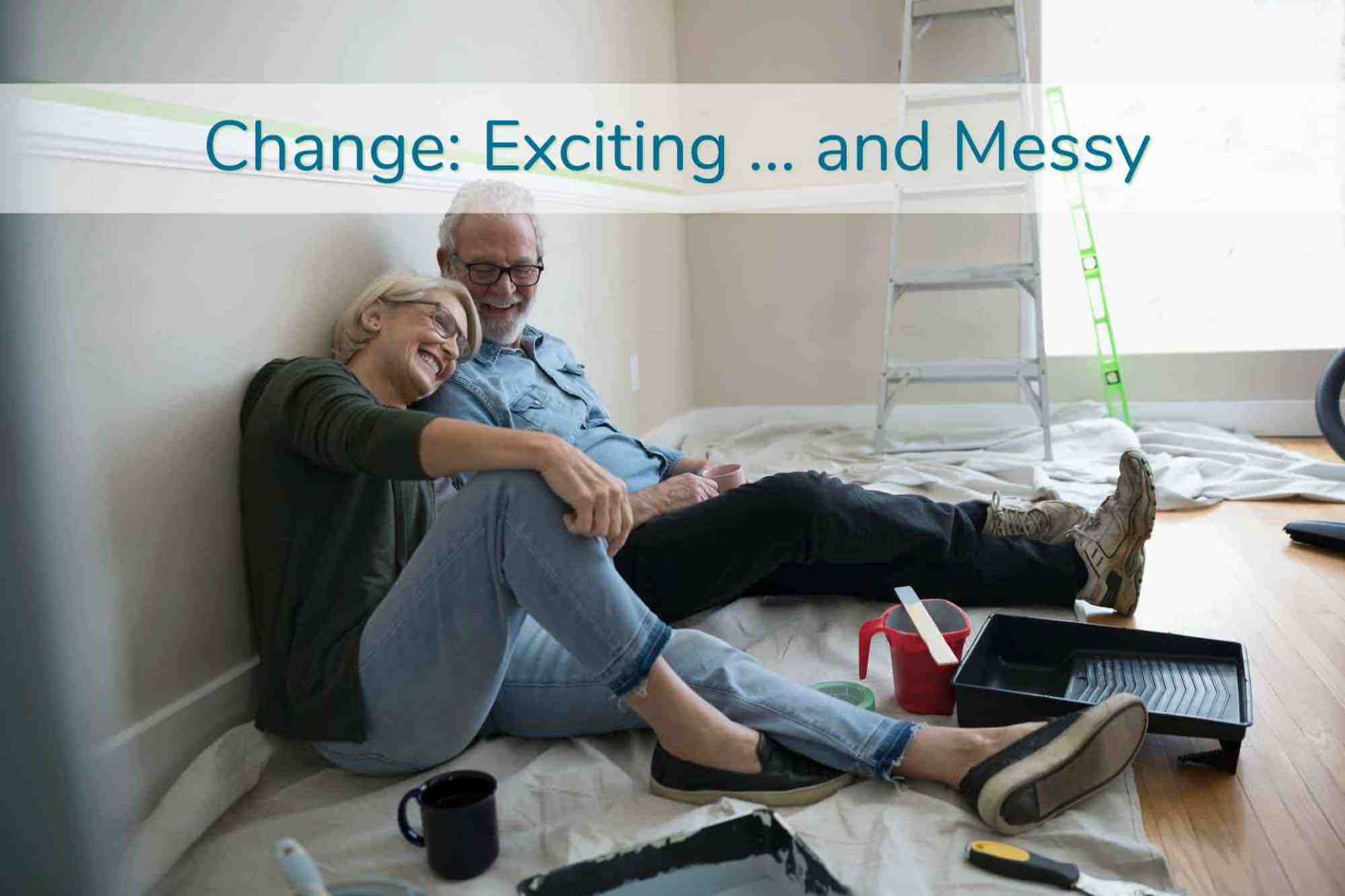Older couple enjoying a moment of laughter while painting a room at home