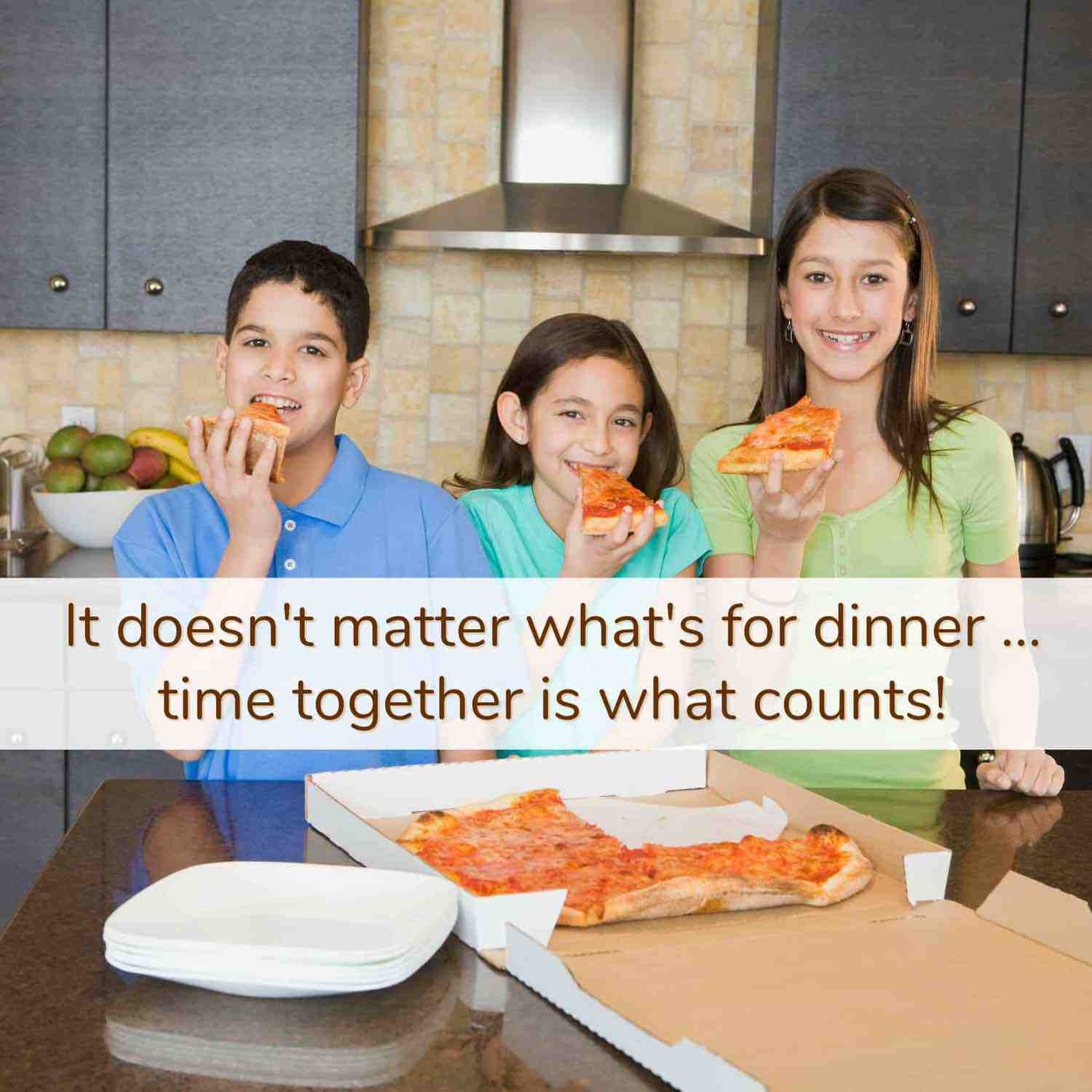 3 happy siblings eating pizza at the kitchen counter