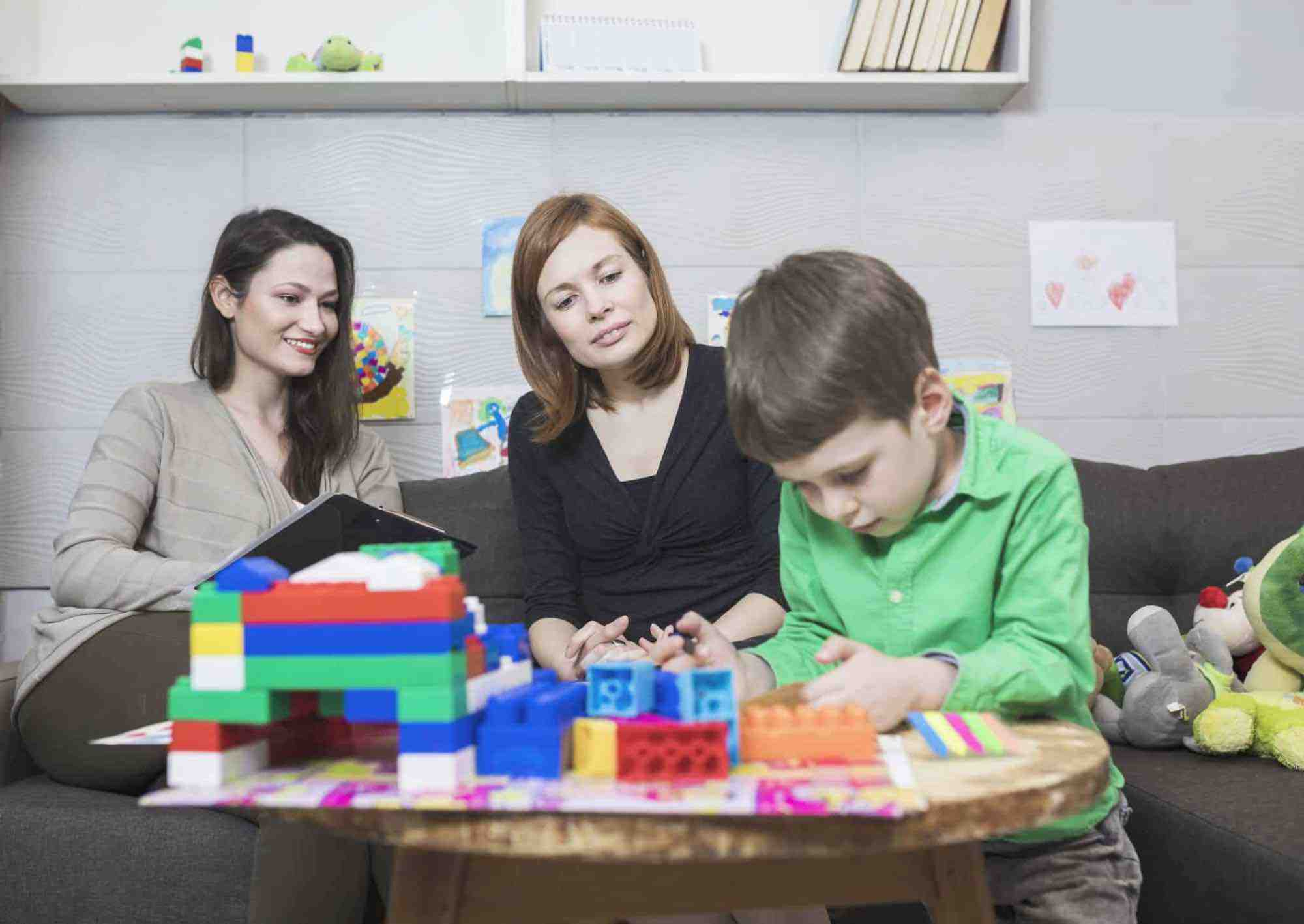 Mom, Child and Autism Assessment Therapist in clinical setting
