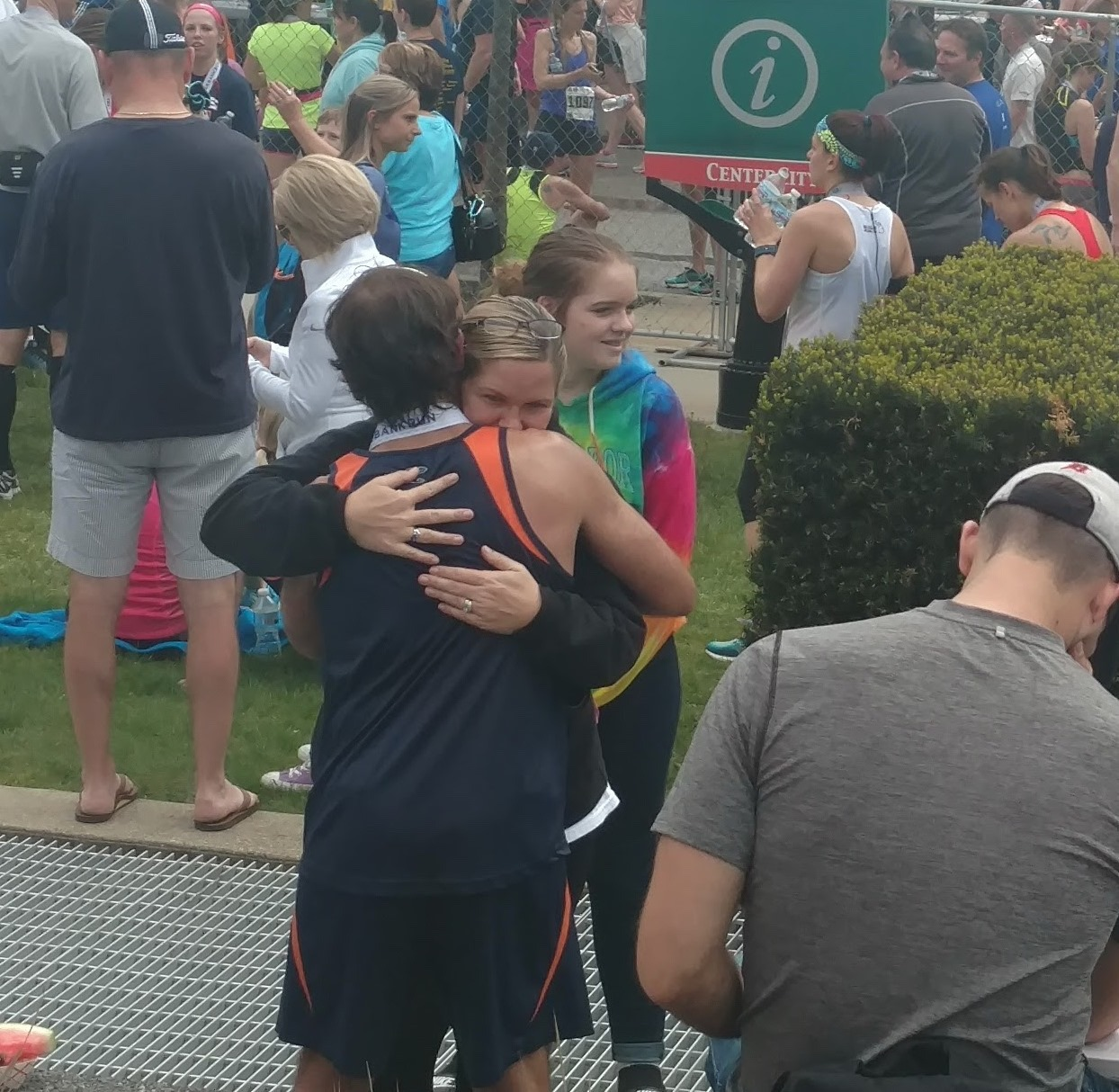 Runners hugging at the finish of the 5/3 River Bank Run 2017
