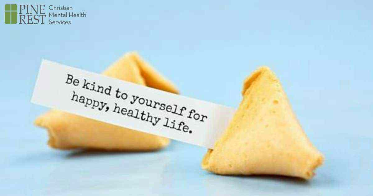 Fortune cookie with message: 'Be Kind to yourself for happy, healthy life.'