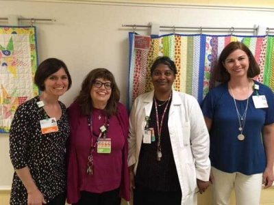 (Left to right) Mother & Baby Program team members: Case Manager Naomi Savoie-Miller, LMSW; Nurse Practitioner Robi Thomas, PHD, RN, PMHNP-BC; Reproductive Psychiatrist Madhavi Nagalla, MD; and Case Manager Mary Zuidema, LMSW.