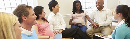 Pregnant Women With Partners At prenatal Class