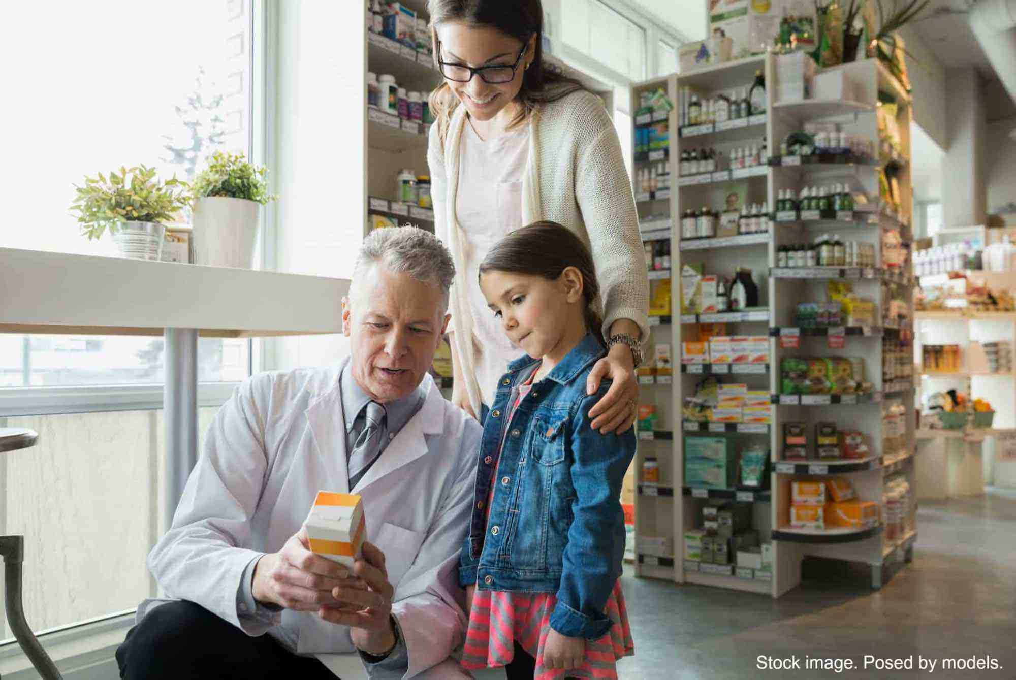 Mom & Young Daughter Talking to Pharmacist