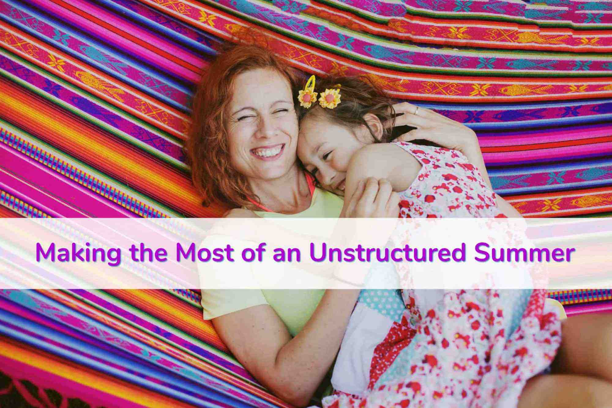 Smiling mom cuddles young daughter in hammock