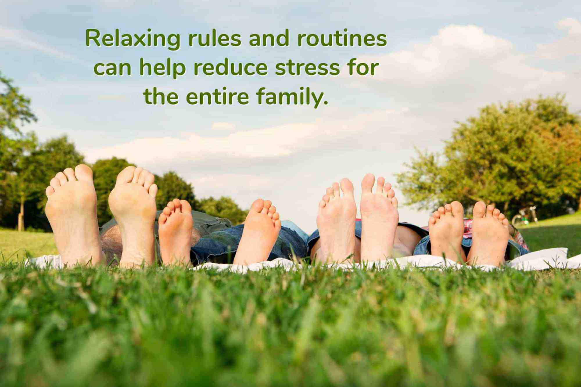 A family's bare feet lined up in a row as they lie in the grass together
