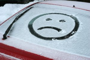 Sad Face in snow on car