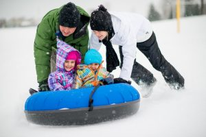 Tubing and sledding down a hill